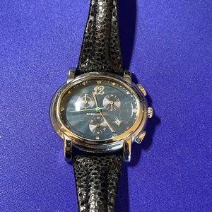 BCBG Silver watch with black leather strap.
